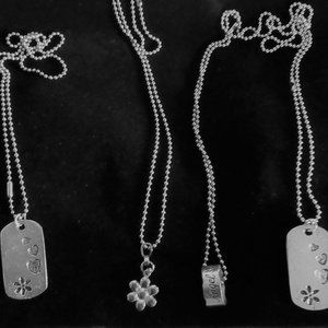 4 Necklaces on sink chains
